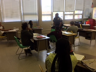 officer speaks to students